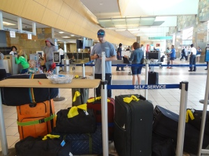 2nd Man trying to figure how to check 13 bags of crazy onto the plane
