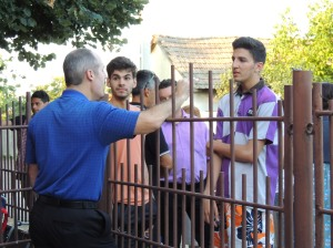 2nd Man talking with some teen boys in Rogova